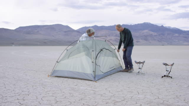 Adventurous Seniors Setting up a Tent