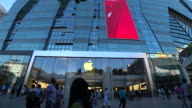 Advertisement of iPhone 7 'China Red' on the glass wall of an Apple shop located at Xidan business street Though designed for the Chinese market...
