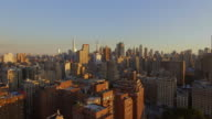 aerail view of new york city metropolis at sunset. skyline establishing shot