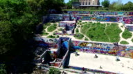 Aerial Above Austin Texas Hill Country looking down at the Castle Hill Graffiti wall with Hills , castle , and outdoor public graffiti wall in view in the air over ATX 2016 drone view close view