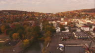 Aerial Approach over water to Town in Upstate New York