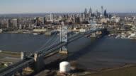Aerial approach to Philadelphia across edge of Camden and the Benjamin Franklin Bridge. Shot in 2011.