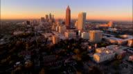 Aerial approaching downtown/ Bank of America Plaza/ traffic on motorway/ SunTrust Plaza/ Atlanta, Georgia
