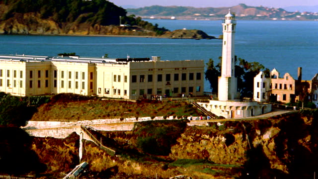 Aerial around prison on Alcatraz Island in bay / San Francisco, California
