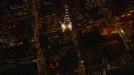 Aerial -At night, a vertical looking pass directly over the Chrysler building in mid-town Manhattan.