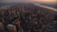 Aerial -At sunset, flying south along Broadway from mid-town Mahattan looking south toward the Freedom Tower with a tilt down over Times Square.