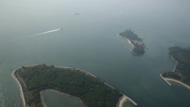 Aerial birds eye view the Southern Islands of Kusu Island top left St Johns Island top right Lazarus Island top center connected with reclaimed land...