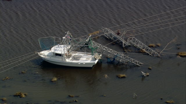 Aerial boat tangled in fallen power lines and electrical towers / New Orleans Lousiana