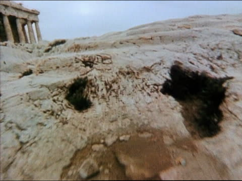 1978 aerial CAM moving across the ground near the Acropolis / Greece