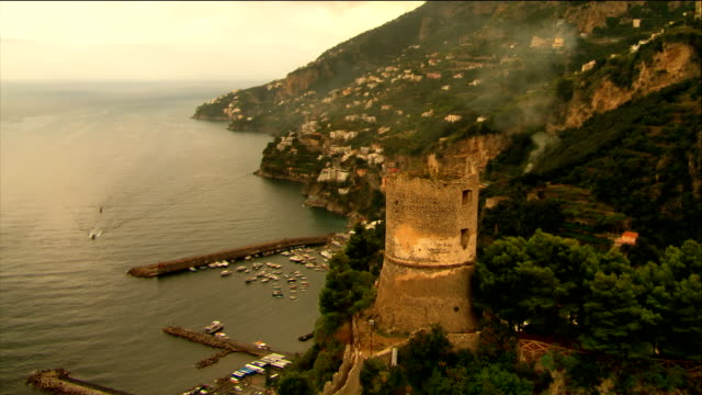 Aerial castle overlooking town and coast of Amalfi / Italy