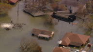Aerial Chinook helicopter carrying sand bags to broken levee on London Ave Canal /New Orleans low angle