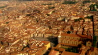 Aerial circling over Basilica of Santa Croce with view of Santa Maria del Fiore and  Arno / Florence