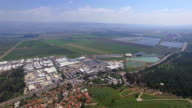 Aerial City of Qiryat shemona / Upper Galilee, Hula valley and Mt Hermon in background
