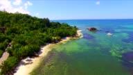 Aerial: coastline of Praslin Island, Seychelles