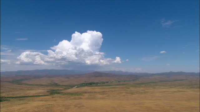 Aerial developing thunderstorm over arid landscape / Central Arizona