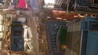 Aerial directly over Broadway going downtown through Times Square, evening NYC