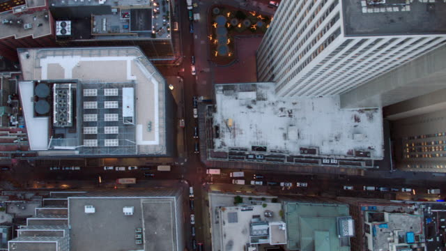Aerial directly over lower Manhattan financial district, Following Wall street to East river, NYC