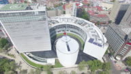 Aerial dolly in to the Mexican flag at the Senado de la Republica in Reforma Avenue, Mexico City