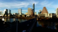 Aerial Drone Flight Over Austin Hovering Above South Congress Avenue Bridge with Deep Perspective of Texas State Capital and Skyline View
