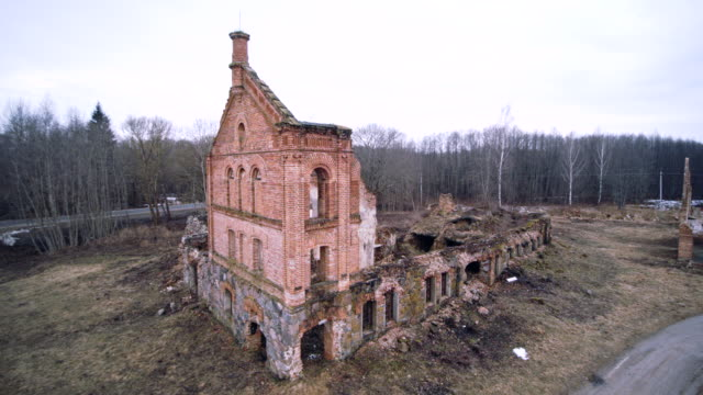 Aerial drone footage of the old ruined industrial building in Shemetovo town, Belarus, Eastern Europe