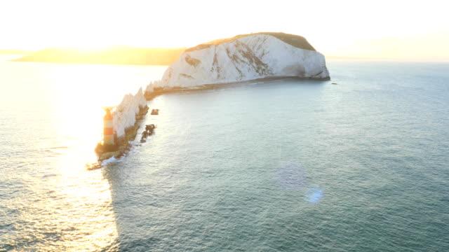 Aerial Drone Needles Alum Bay UK sunrise Landmark