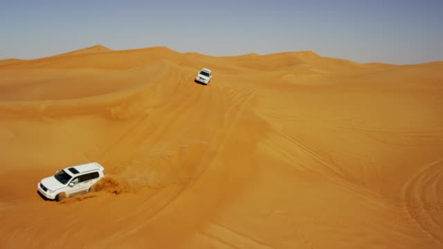 Aerial Drone of 4x4 Vehicles Driving Across Dubai