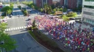 Aerial drone of thousands of runners in race