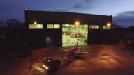 Aerial Drone Point of View Night shots Red Arrows jets BAE Hawk T 1 in hangar at RAF Scampton Aerial Drone night shot Red Arrow jet being towed from...