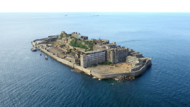 Aerial Drone Shot of Gunkanjima one of the UNESCO World Heritage sitesLandscape of Hashima island looked from the sky