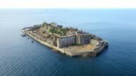 Aerial Drone Shot of Gunkanjima one of the UNESCO World Heritage sitesLandscape of Hashima island looked from the sky