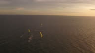 Aerial drone shot of kite race at sunset
