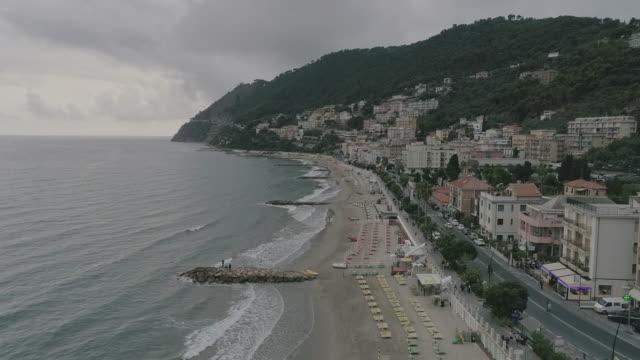 Aerial drone view of coastal town, beach and sea