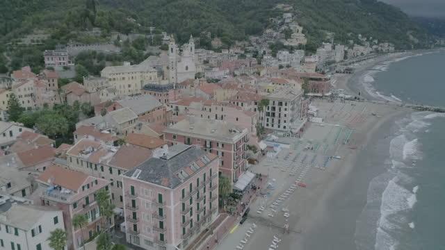 Aerial drone view of coastal town Camogli, beach and sea