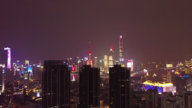 Aerial drone view of Shanghai city lights at night