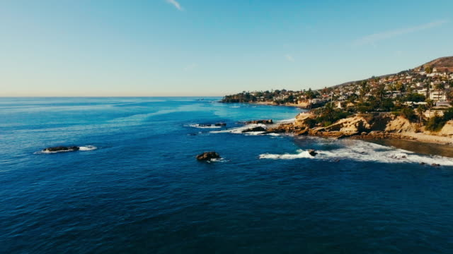Aerial drone view of the pacific ocean and the reef in Southern California's Laguna Beach.
