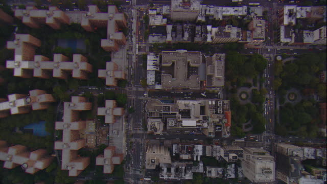 Aerial -Early evening vertical tracking shot looking down on buildings and traffic in lower Manhattan.