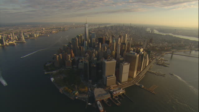 Aerial -Early morning high-angle wide view of Manhattan and the Freedom Tower as seen from over Battery Park.