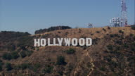 Aerial TS fast towards Hollywood Sign / Hollywood Hills, California, United States