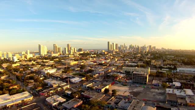 Aerial flight around Wynwood Art District, afternoon light skyline view in Miami Florida.