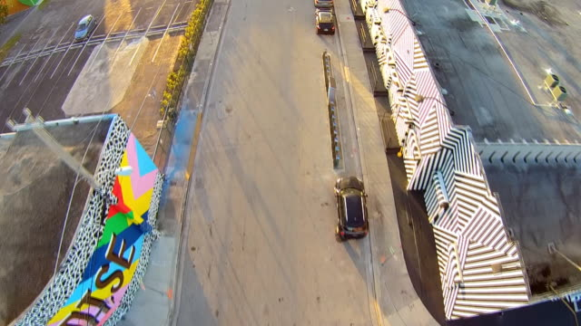 Aerial flight around Wynwood Art District, down road in Miami Florida.