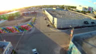 Aerial flight around Wynwood Art District, street corner in Miami Florida.