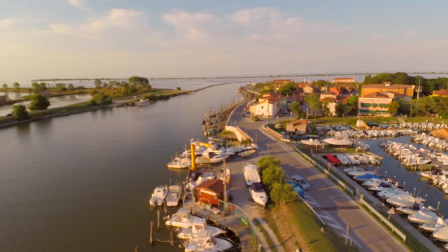 Aerial flight over harbor in Po river delta