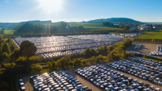 Aerial flight over new car storage parking lot