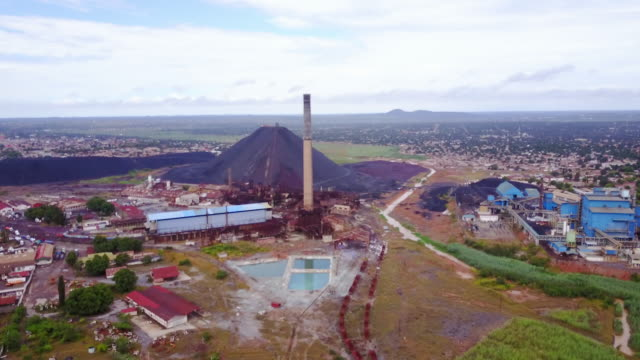 Aerial flying away from copper mine, daytime Lubumbashi, Congo, Africa