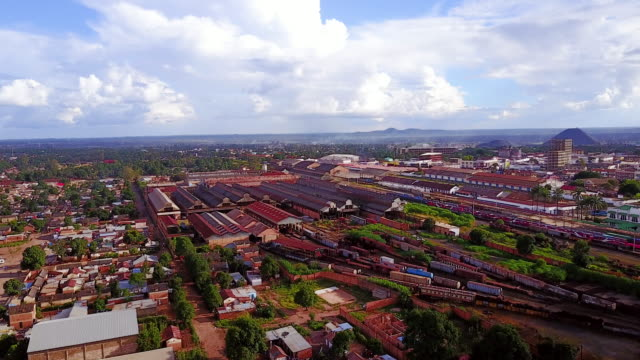 Aerial flying low over Train station, daytime Lubumbashi, Congo, Africa