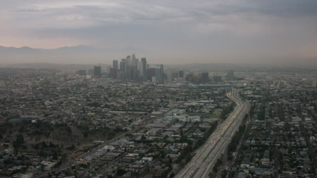 Aerial flying over 10 freeway in Los Angeles, CA morning