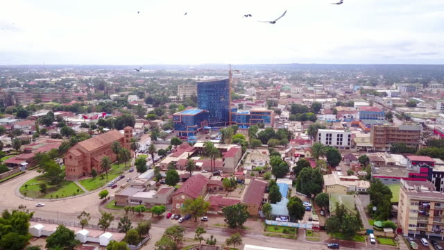 Aerial flying over center of Lubumbashi city, Congo, in Africa