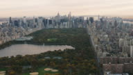 Aerial flying over Central Park covered in Fall foliage in NYC