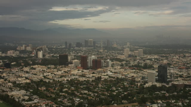 Aerial flying over Century City in Los Angeles, CA sunset