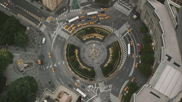 Aerial flying over Columbus Circle and traffic moving around in NYC